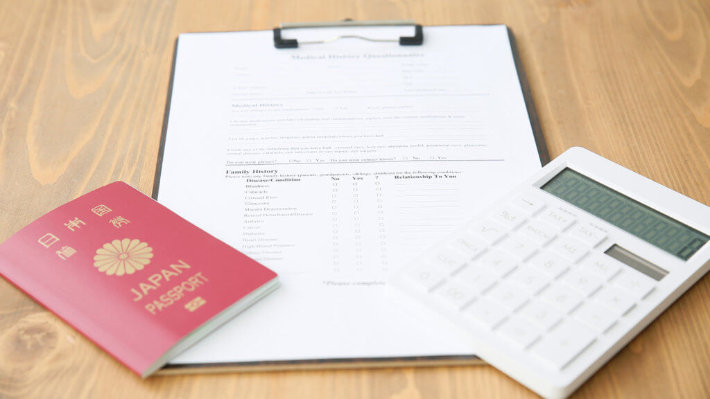 カルテとパスポートと電卓